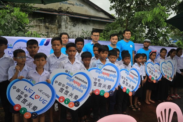 """Cambodian children participate in CHD's """"We Care, We Love"""" public open day. In recent years, CHD's """"We Care We Love"""" activities have expanded from China to Cambodia, including Public Open Day and other events, affecting the local communities with a genuine, devoting and loving spirit."""
