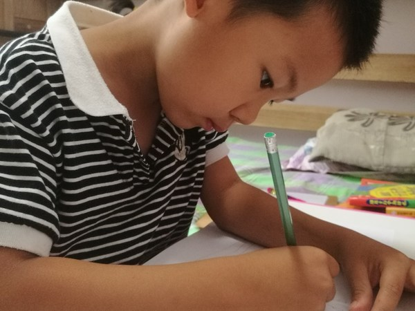 A child participating in Future Energy Painting Contest. The Future Energy Painting Contest provides aesthetics education through art for children around the world and promotes harmony between humans and nature.