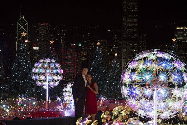 "Visitors enjoy ""Christmas Lighting & Music Show"" with the amazing skyline as a backdrop in Harbour City, Hong Kong."