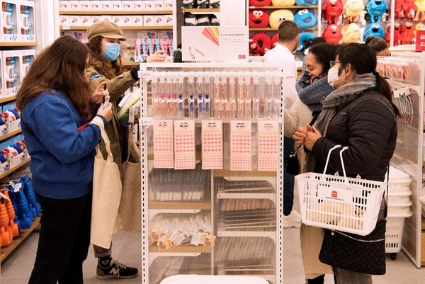 Spanish customers shopping in MINISO stores