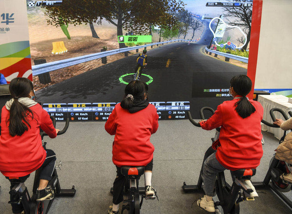 Visitors experiencing a cycling game