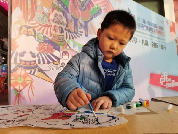 Children learning to make kites