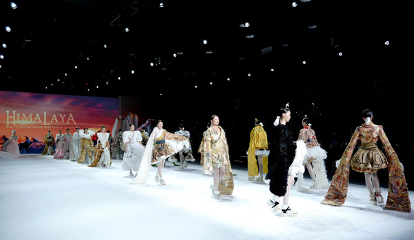 The models display the Himalaya-themed haute couture fashion works designed by the well-known fashion designer Guo Pei during the 2020 International Fashion Week on December 5.