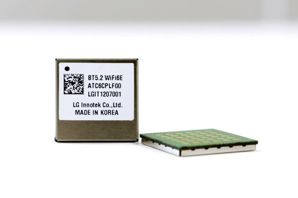 An LG Innotek employee presents the automotive Wi-Fi 6E module. This module enables near-field wireless communication both inside and outside the vehicle with improved communication performance, durability, and applicability.