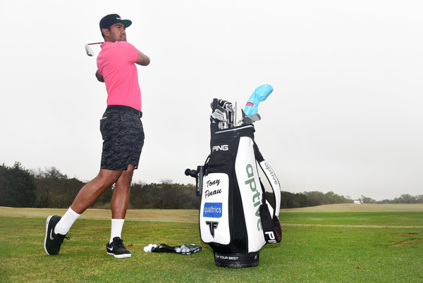 SAN ANTONIO, TEXAS - MARCH 30: Tony Finau uses the Hyperice device on the driving range at the Valero Texas Open on March 30, 2021 in San Antonio Texas (Photo by Steve Dykes/Getty Images for Hyperice)