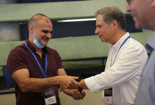 Meni Itzhak, CardiacSense VP R&D, with Eytan Stibbe, Israeli second astronaut. Credit: Elad Malka