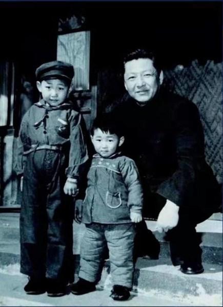 File photo of Xi Zhongxun (R) with his sons Xi Jinping and Xi Yuanping.