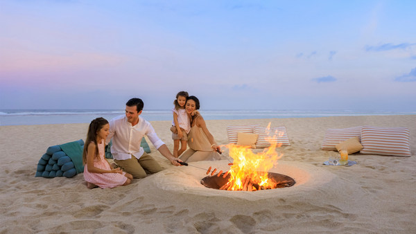 Enjoy unforgettable family holiday with a fun bonfire by the beach at The Ritz-Carlton, Bali