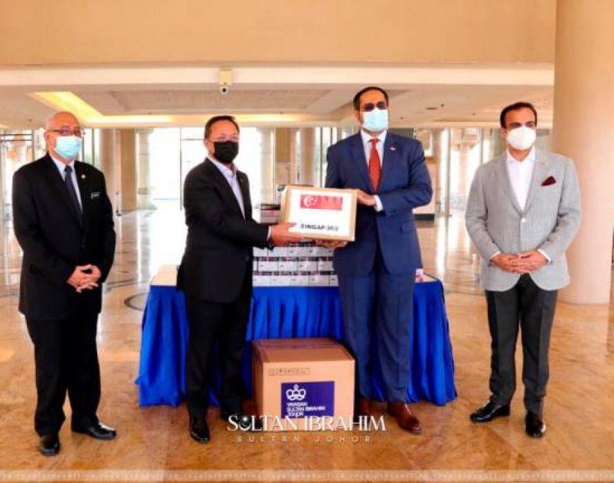 YSIJ, Singapore contribute RTK-AG test kits to Johor