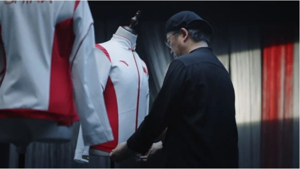Tim Yip presents the podium outfits to the Chinese sports delegation