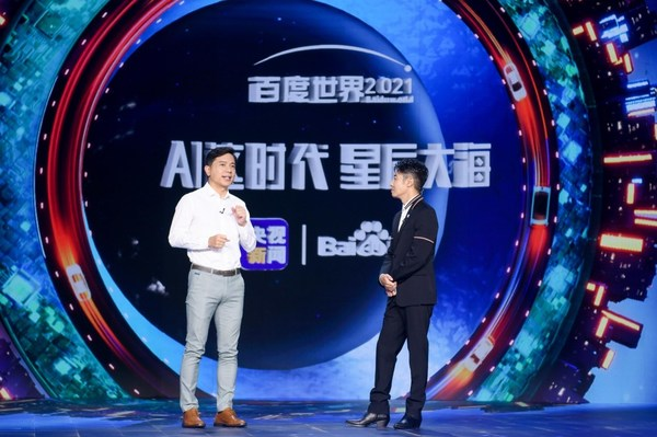 Baidu Co-founder and CEO Robin Li and CCTV Host Beining Sa on stage at Baidu World 2021