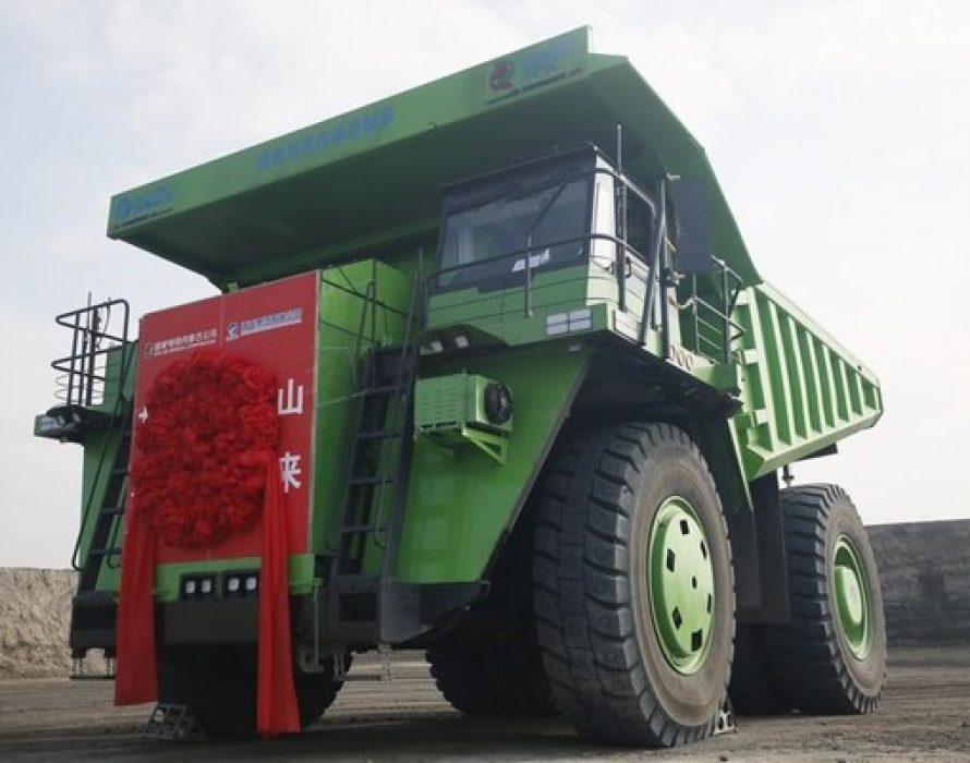 Huge electric dump truck goes to work at coal mine