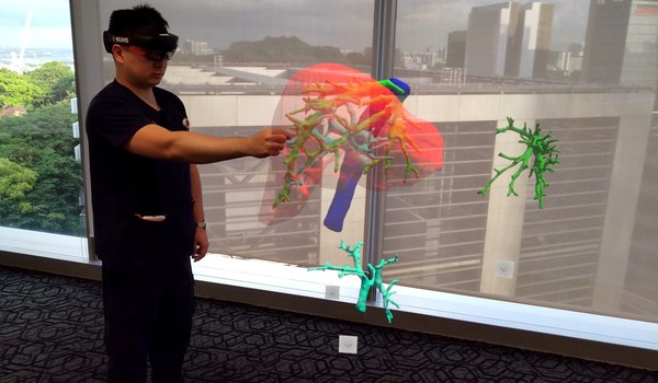 With the help of a Mixed Reality headset, a three-dimensional hologram of a patient's liver scan is projected into space, allowing Dr Gao Yujia, Associate Consultant with the Division of Hepatobiliary & Pancreatic Surgery, National University Hospital, and the programme lead for the holomedicine programme at the National University Health System to control and view the holographic image from different angles.