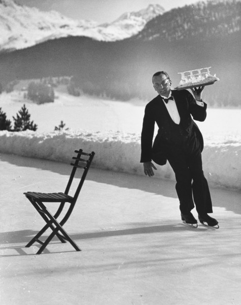 Rights and Clearance is a dedicated service for Shutterstock's global customer base that obtains third party permissions across the entire portfolio of assets for promotional use. Image caption: Waiter Rene Breguet at waiter's school on skates practicing carrying tray of cocktails while on the ice at the Grand Hotel. By: Alfred Eisenstaedt/The LIFE Picture Collection/Shutterstock