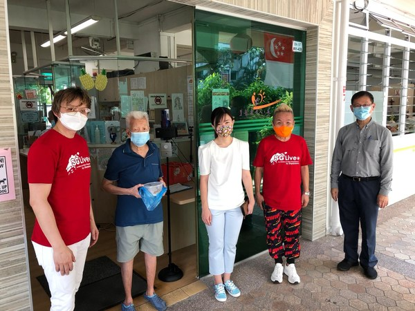 Ms Tin Pei Ling (Center) with volunteers at GEHA