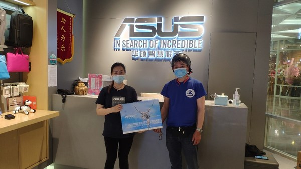 A Dada rider takes online orders for delivery at an ASUS store in Shanghai